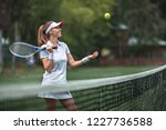 smiling woman with a racket and ... | Shutterstock . vector #1227736588