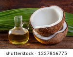 coconut and coconut oil on wood ... | Shutterstock . vector #1227816775