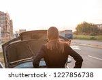 the beautiful brunette looks... | Shutterstock . vector #1227856738