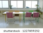 library table for reading at... | Shutterstock . vector #1227859252