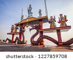 statue of dragons and kwan yin... | Shutterstock . vector #1227859708