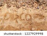 disco inscription on sand.... | Shutterstock . vector #1227929998