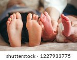 legs of a newborn baby in... | Shutterstock . vector #1227933775
