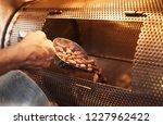 closeup of a hands of worker in ...   Shutterstock . vector #1227962422