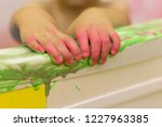 the child plays in the bathroom ...   Shutterstock . vector #1227963385