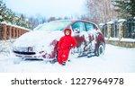 Boy Near A Snowy Red Car On A...