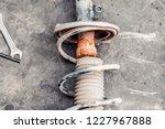 disassembled car shock absorber.... | Shutterstock . vector #1227967888