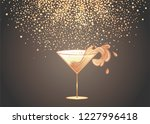 cocktail glass with splash over ... | Shutterstock .eps vector #1227996418