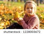 girl 4 years old walks in... | Shutterstock . vector #1228003672