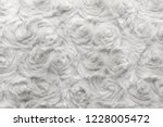 white natural wool with twists... | Shutterstock . vector #1228005472