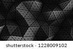 black polygonal wall geometric... | Shutterstock . vector #1228009102