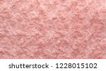 pink natural wool with twists... | Shutterstock . vector #1228015102