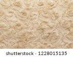 beige natural wool with twists... | Shutterstock . vector #1228015135