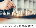 businessman playing chess game... | Shutterstock . vector #1228045228