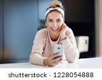 happy woman texting in the...   Shutterstock . vector #1228054888