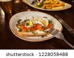 bruschetta with smoked salmon... | Shutterstock . vector #1228058488