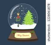 christmas snow globe on the... | Shutterstock . vector #1228061878