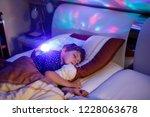 little preschool kid boy... | Shutterstock . vector #1228063678