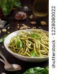 spaghetti pasta with pesto... | Shutterstock . vector #1228080022