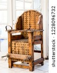 old wooden chair with spikes... | Shutterstock . vector #1228096732