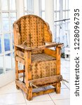 old wooden chair with spikes... | Shutterstock . vector #1228096735