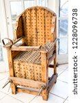 old wooden chair with spikes... | Shutterstock . vector #1228096738