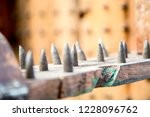 old wooden chair with spikes... | Shutterstock . vector #1228096762