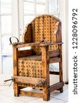 old wooden chair with spikes... | Shutterstock . vector #1228096792