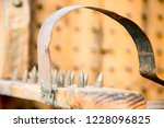 old wooden chair with spikes... | Shutterstock . vector #1228096825