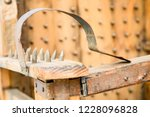 old wooden chair with spikes... | Shutterstock . vector #1228096828