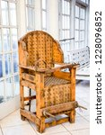 old wooden chair with spikes... | Shutterstock . vector #1228096852