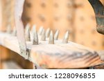 old wooden chair with spikes... | Shutterstock . vector #1228096855