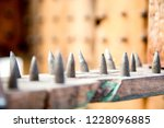old wooden chair with spikes... | Shutterstock . vector #1228096885
