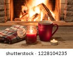 red mug with hot tea  and a... | Shutterstock . vector #1228104235