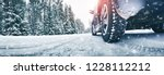 closeup of car tires in winter... | Shutterstock . vector #1228112212