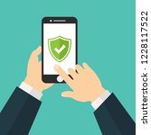 green shield on smartphone... | Shutterstock .eps vector #1228117522