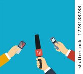 journalists holding microphones ... | Shutterstock . vector #1228138288