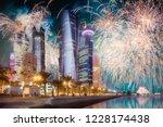 beautiful fireworks above park... | Shutterstock . vector #1228174438