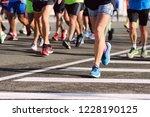 marathon running race. legs of...   Shutterstock . vector #1228190125