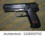hand gun usp p8 is used for... | Shutterstock . vector #1228203742