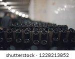 bottles of wine in the wine...   Shutterstock . vector #1228213852