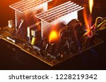 burning wires on the computer... | Shutterstock . vector #1228219342