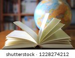 close up of books opened on... | Shutterstock . vector #1228274212