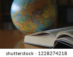 close up of books opened on... | Shutterstock . vector #1228274218