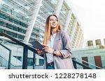 young woman enjoying success... | Shutterstock . vector #1228278148