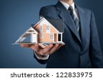 real estate agent offer house... | Shutterstock . vector #122833975