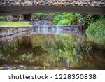image of water stream at pong... | Shutterstock . vector #1228350838