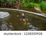 image of asian boy swimming in... | Shutterstock . vector #1228350928