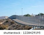 The secured border fence and...