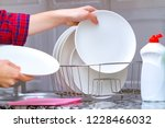 different clean plates in dish... | Shutterstock . vector #1228466032